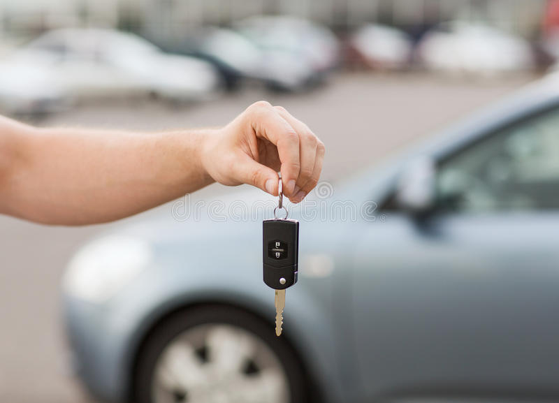 Man with car key outside. Transportation and ownership concept - man with car key outside royalty free stock photo