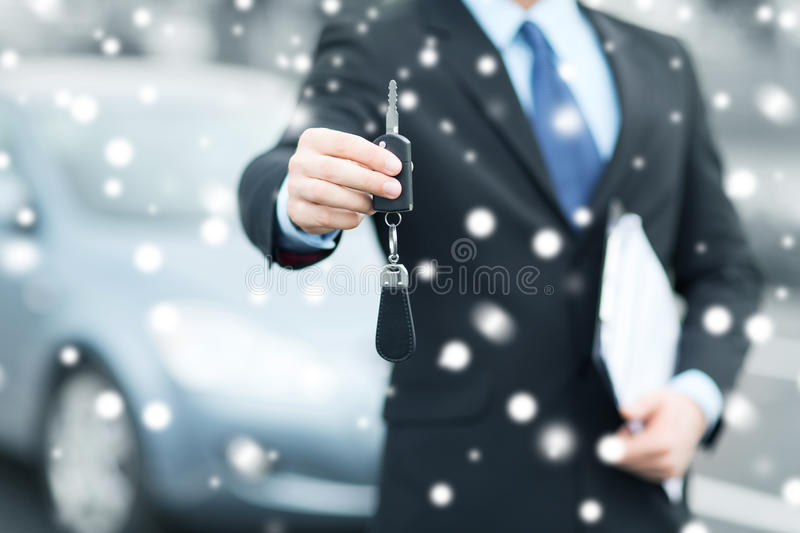 Man with car key outside. Transportation and ownership concept - man with car key outside stock image