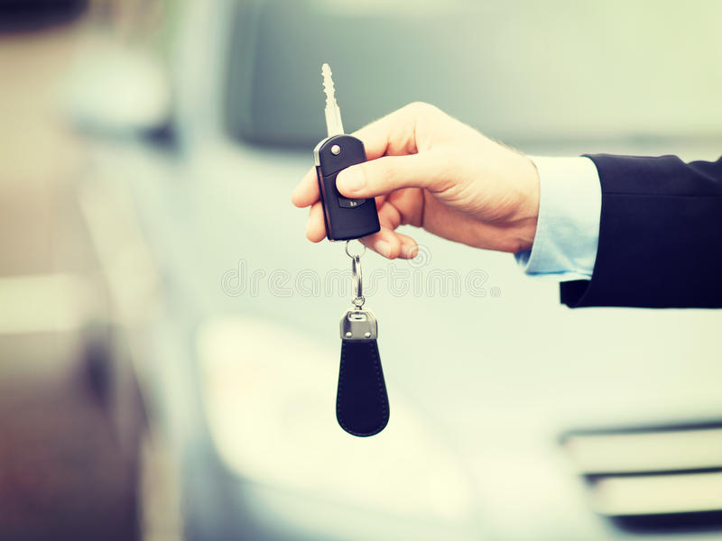 Man with car key outside. Transportation and ownership concept - man with car key outside stock photography