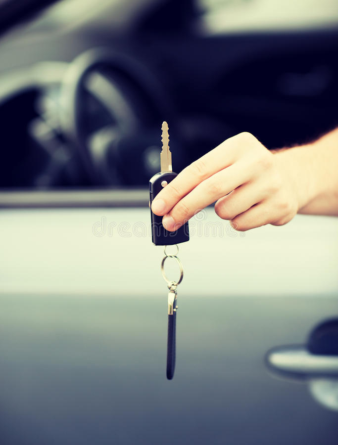 Man with car key outside. Transportation and ownership concept - man with car key outside royalty free stock image