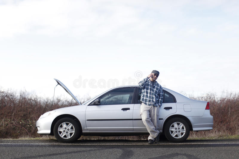 Download Man with car trouble stock photo. Image of assistance - 12686564