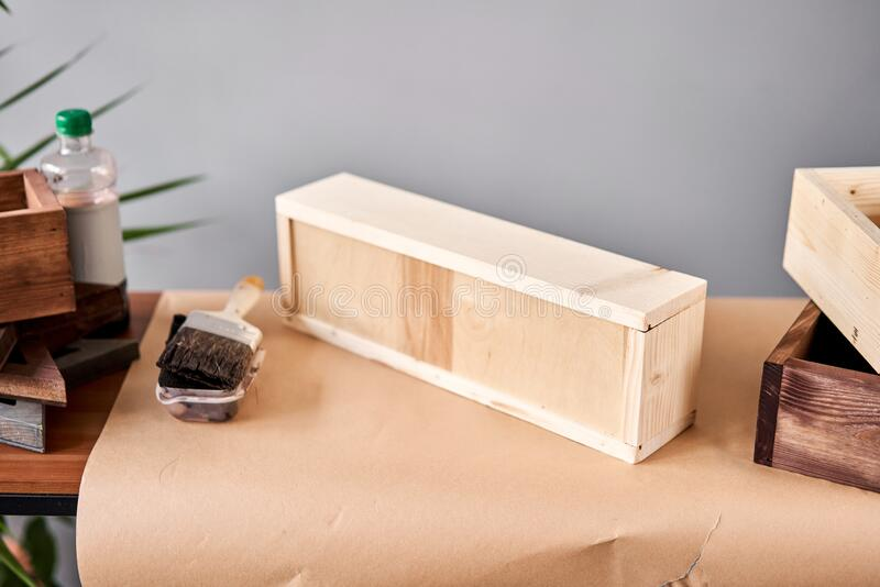 A set of blanks of wooden boxes for flower compositions. Small business woodwork workshop. In your work, do you use royalty free stock photo