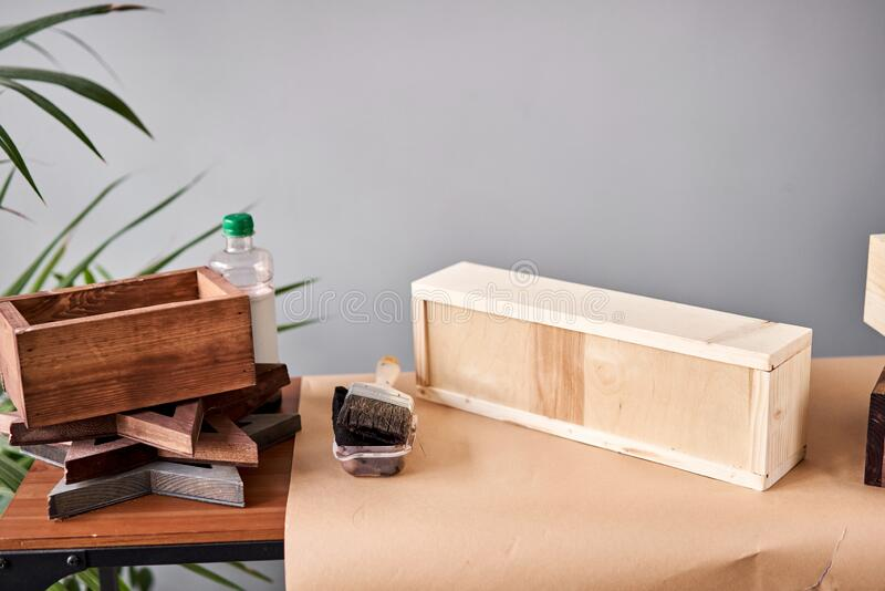 A set of blanks of wooden boxes for flower compositions. Small business woodwork workshop. In your work, do you use stock photo