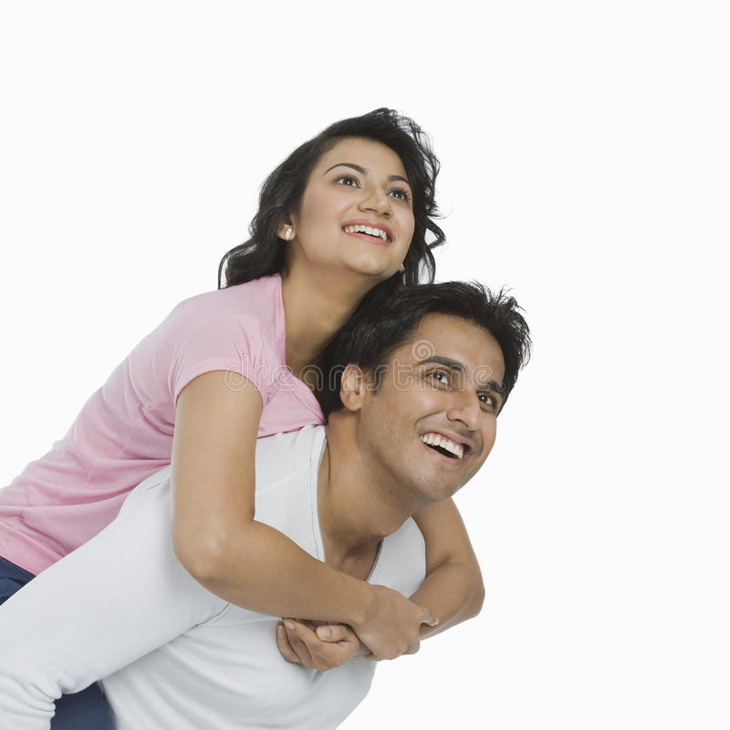 His Girlfriend Is Smiling While Riding Piggyback Stock
