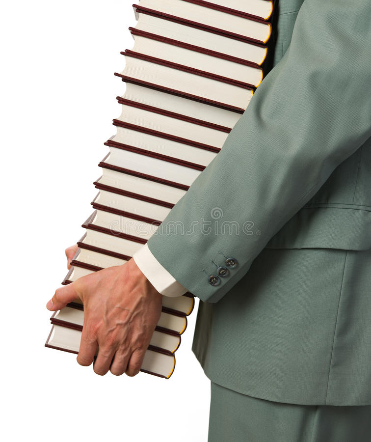 Man carries books stock photo