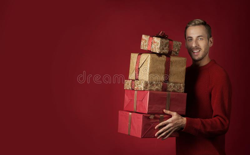 A man carries Christmas gifts stock images
