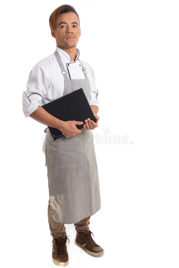 Man carries cookbook. Black cook wears apron. Isolated on white stock photos