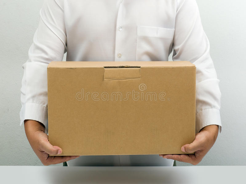 Man carry brown paper box stock images