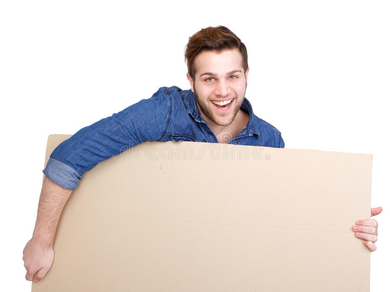 Man carrying blank poster sign. Portrait of a handsome young man smiling and carrying blank poster sign on isolated white background stock images