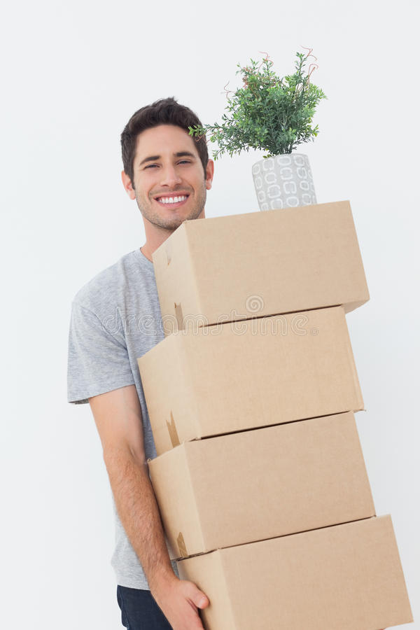 Man carrying boxes because he is moving royalty free stock photos