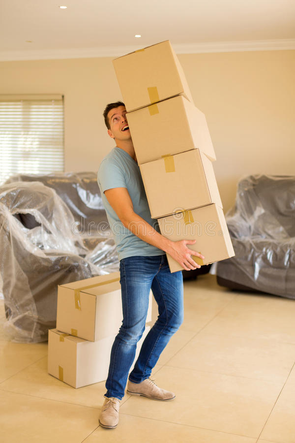 Man carrying cardboard boxes stock image