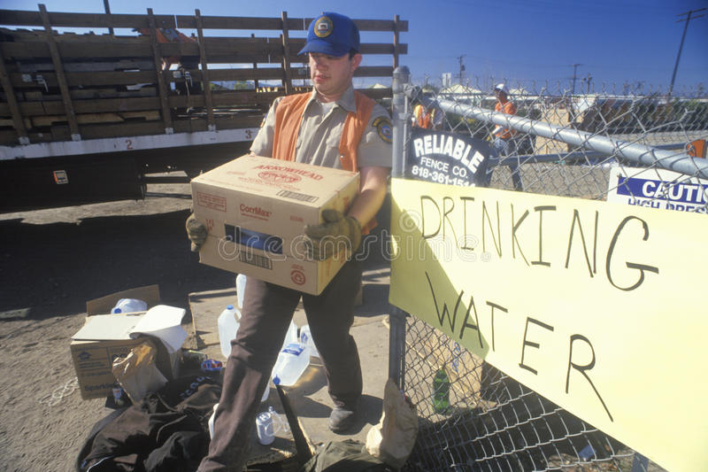 A man carrying drinking water away