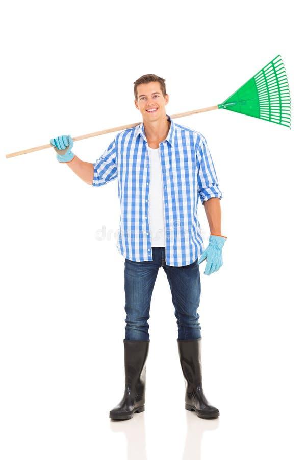 Free Man Carrying Fan Rake Stock Images - 40475534