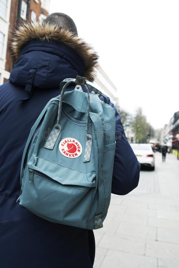 Man carrying a Fjallraven Kanken backpack in London stock photography