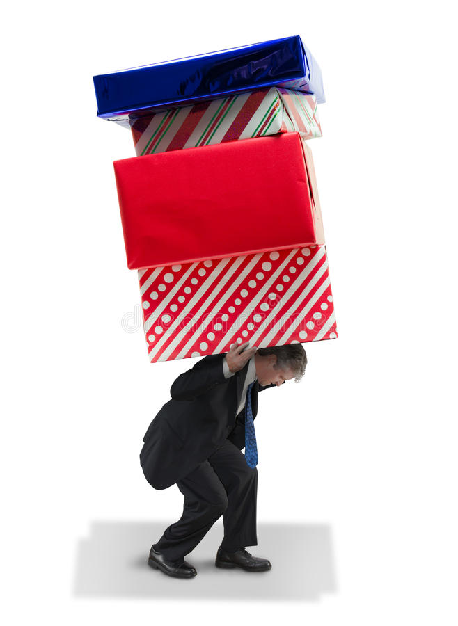 Man carrying giant gifts Christmas and birthday financial burden and stress royalty free stock photo
