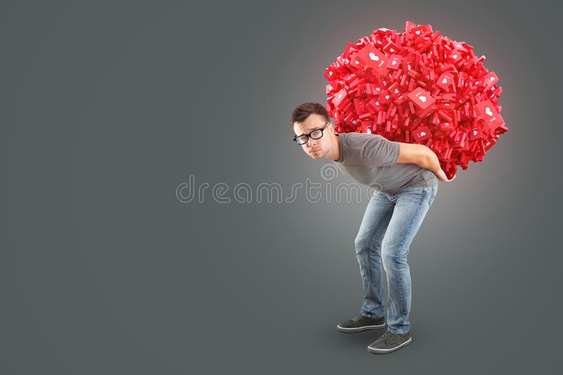 Man carrying a heap of social media Like Symbols on his back. A man in jeans and t-shirt is carrying a 3d rendered heap of social media like symbol on his back stock photography