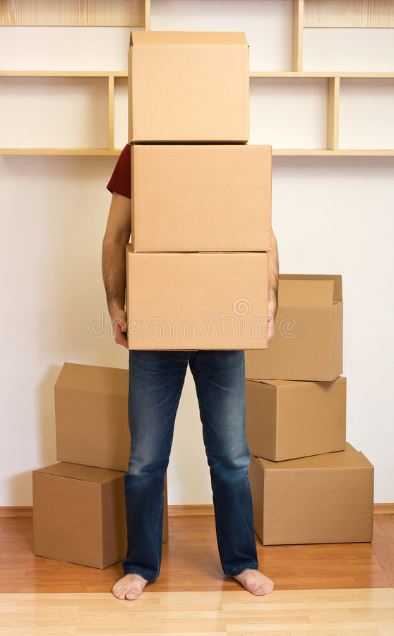 Man carrying lots of boxes - moving concept stock photo