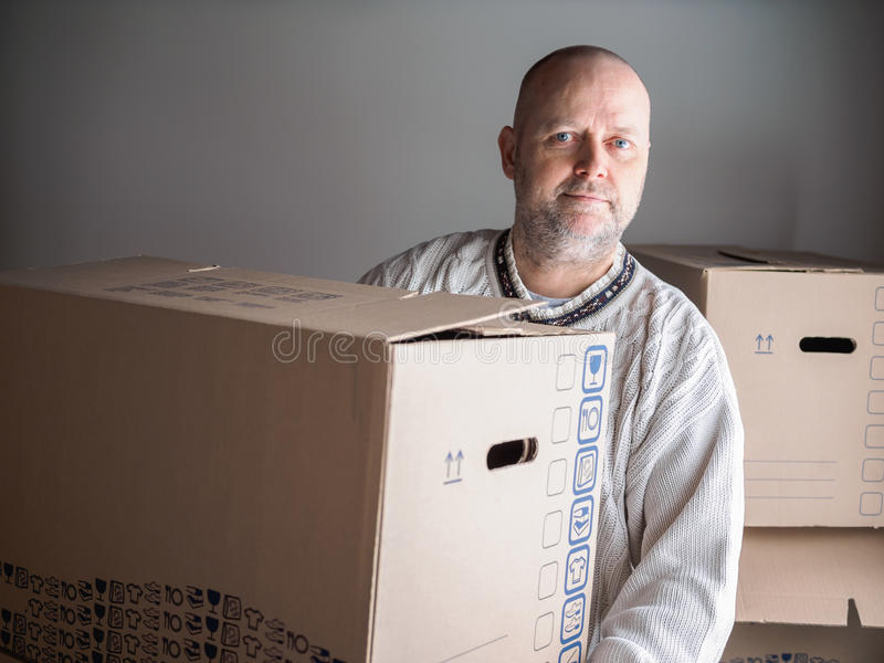 Man carrying moving boxes royalty free stock photography