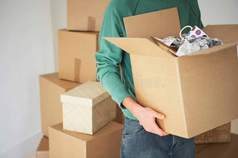 Man Carrying Open Cardboard Box stock images