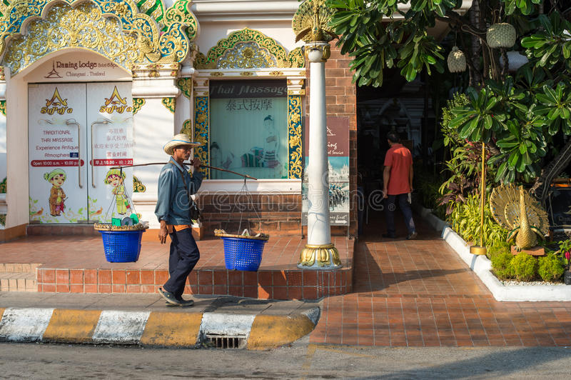 Man with carrying pole in Chiang Mai stock photos