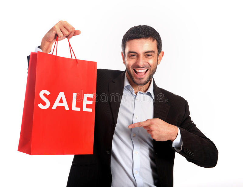 Man carrying a red sale shopping bag. Happy Attractive Man carrying a Red Sale Shopping Bag stock photography