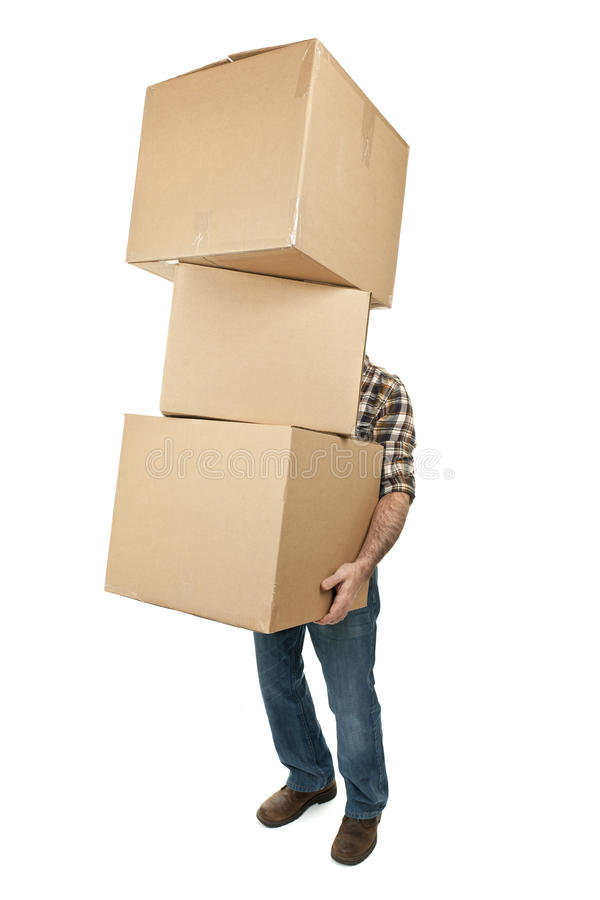 Man carrying stack of cardboard boxes royalty free stock photo