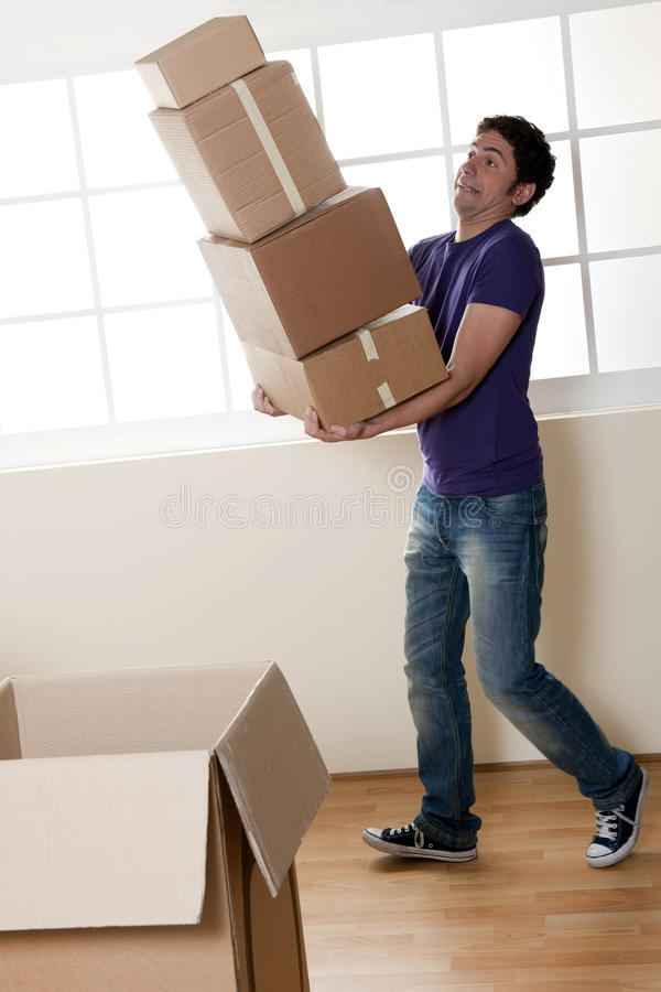 Download Man Carrying Stacked Boxes stock photo. Image of home - 17245606