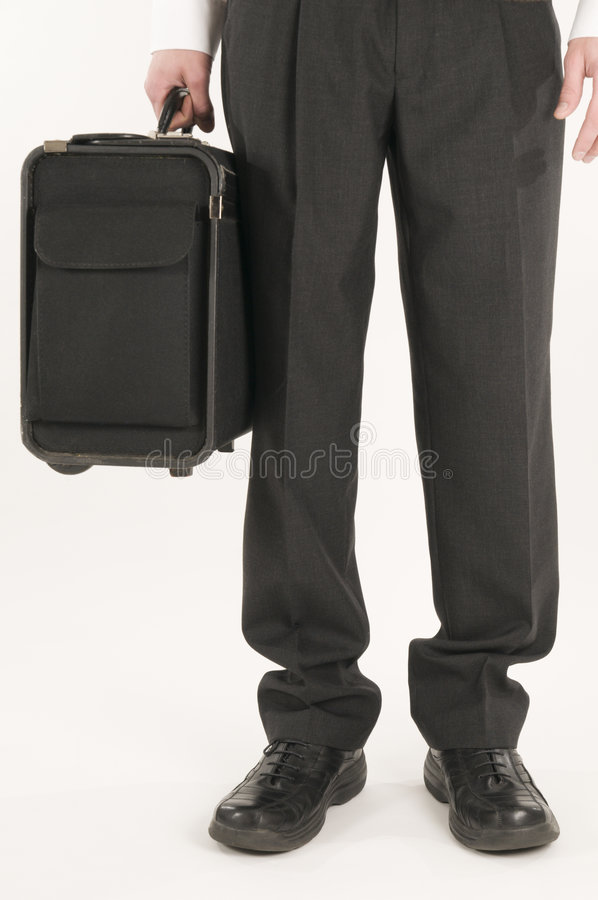 Man carrying suitcase stock photography