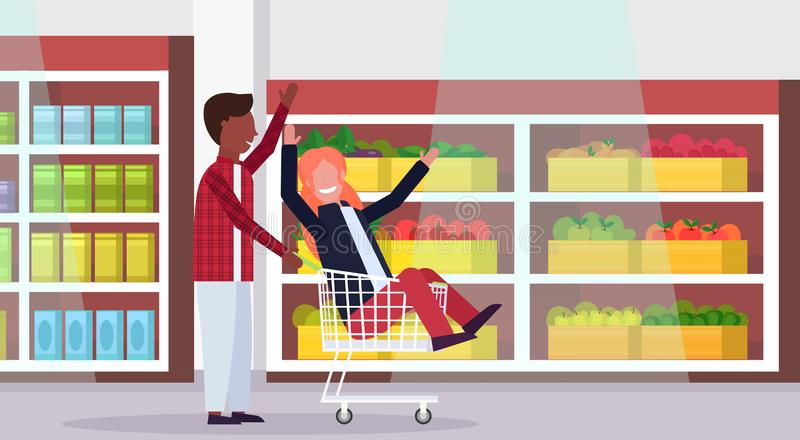 Man carrying trolley cart with woman happy mix race couple having fun supermarket interior shopping concept male female. Cartoon characters full length stock illustration
