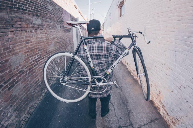 Man Carrying White And Black Bianchi Road Bike stock photos