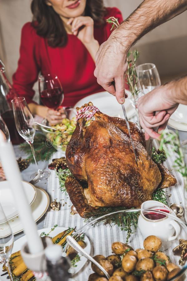 Man carving roasted turkey stock images