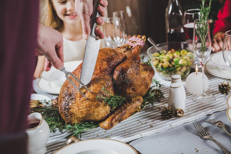 Man carving roasted turkey stock photo