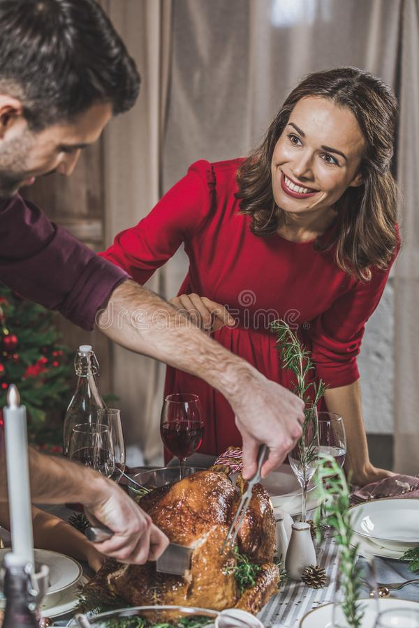 Man carving roasted turkey royalty free stock photography