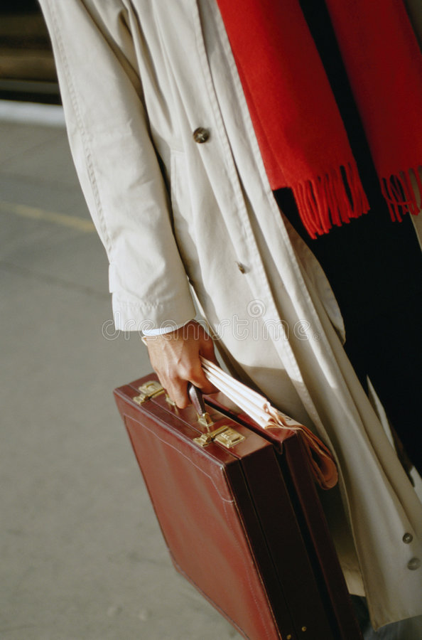 Man with case in hand royalty free stock photography