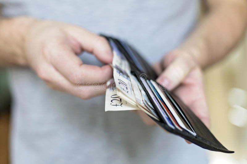 Man with cash inside wallet royalty free stock photos