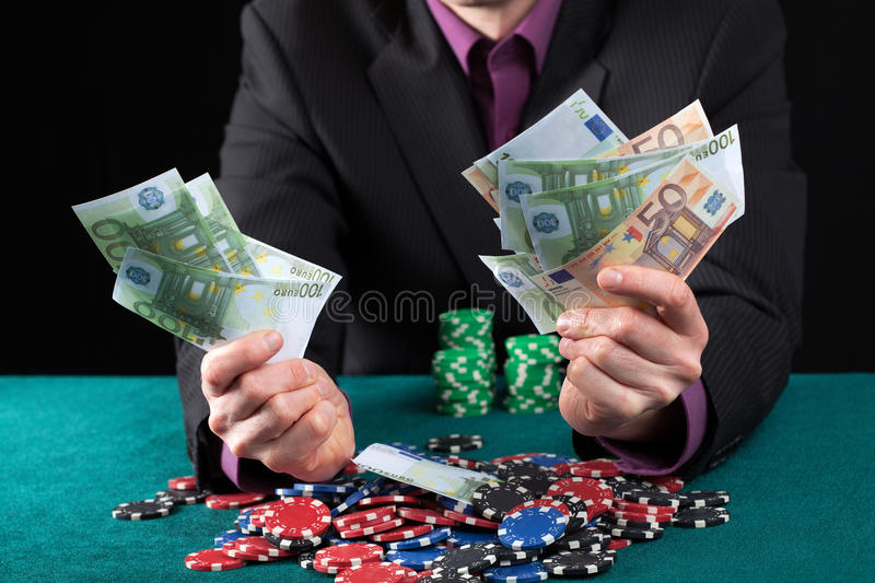 Man in casino wins heap of money royalty free stock images
