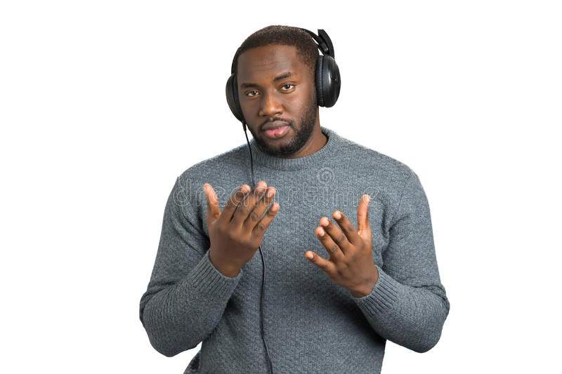 Man in casual wear with headphones. stock photo
