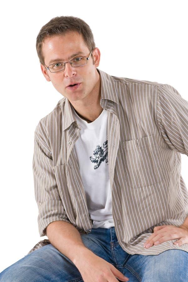 Man casually sitting on stool stock image