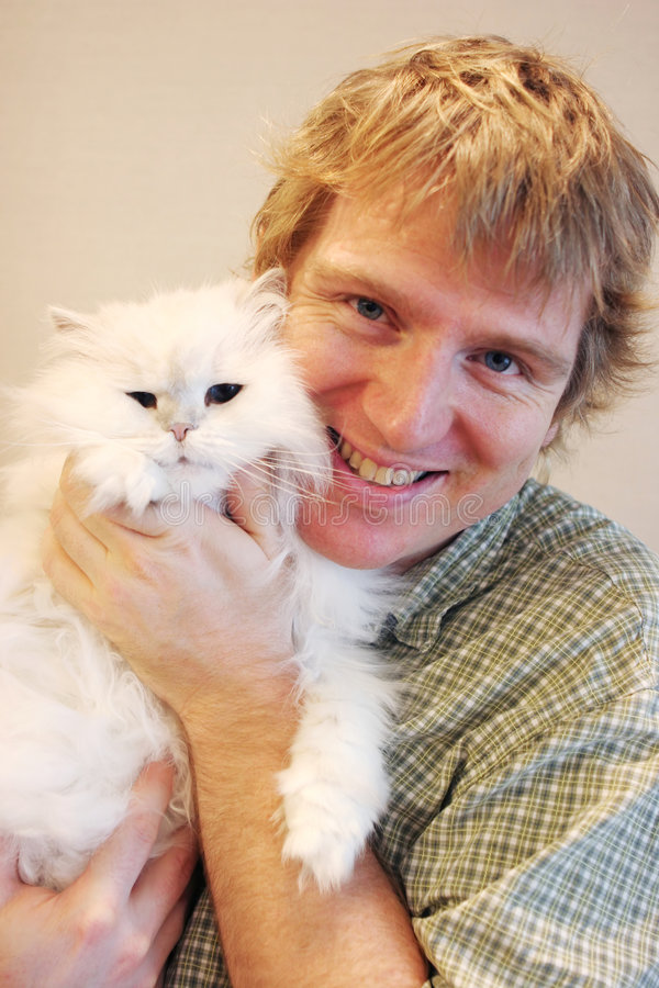 Download Man and cat stock photo. Image of fussy, happy, hairy - 2491330