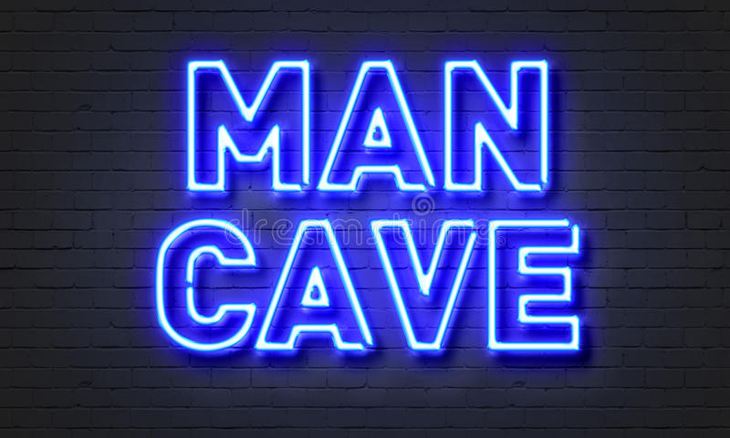 Man cave neon sign on brick wall background. Man cave neon sign on brick wall background royalty free stock image
