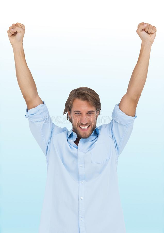 Man celebrating against blurry blue and white background royalty free stock photos
