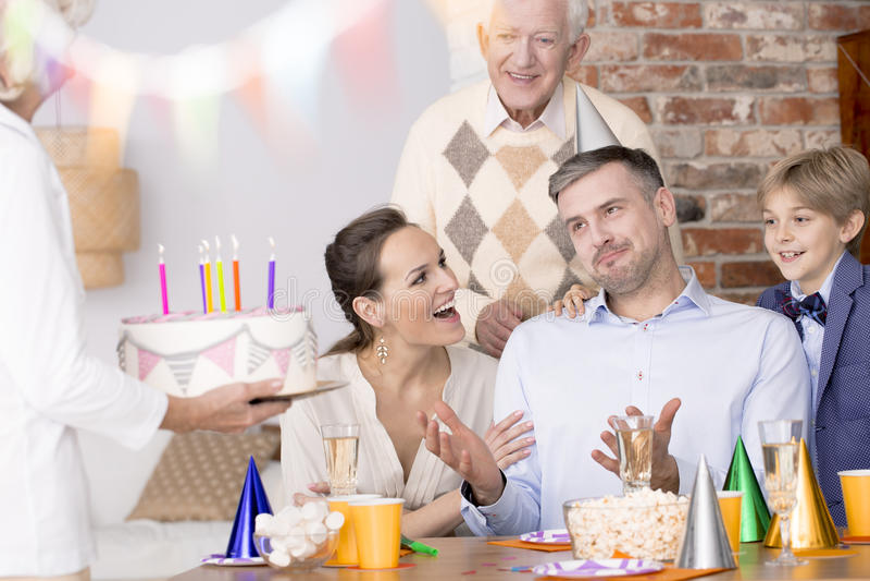 Man celebrating birthday with family royalty free stock photo