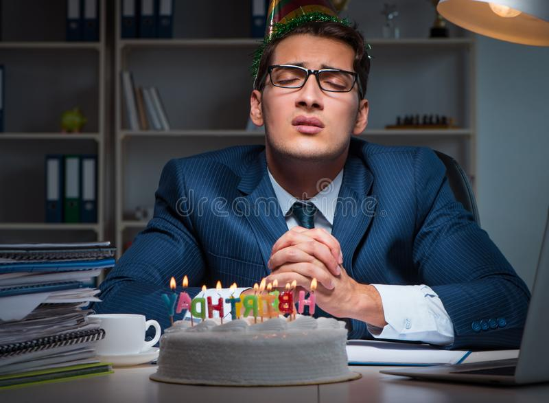 Man celebrating birthday in the office. The man celebrating birthday in the office stock images