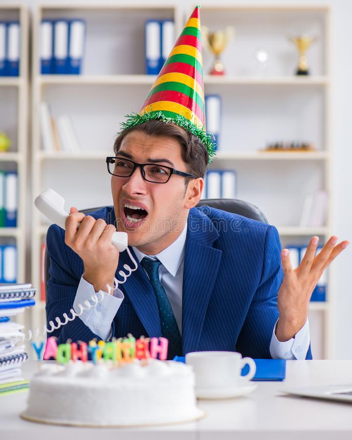 Man celebrating birthday in the office. The man celebrating birthday in the office royalty free stock image