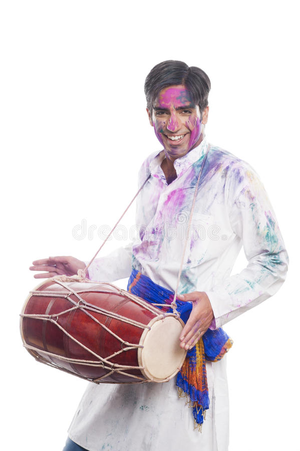 Man celebrating Holi stock images