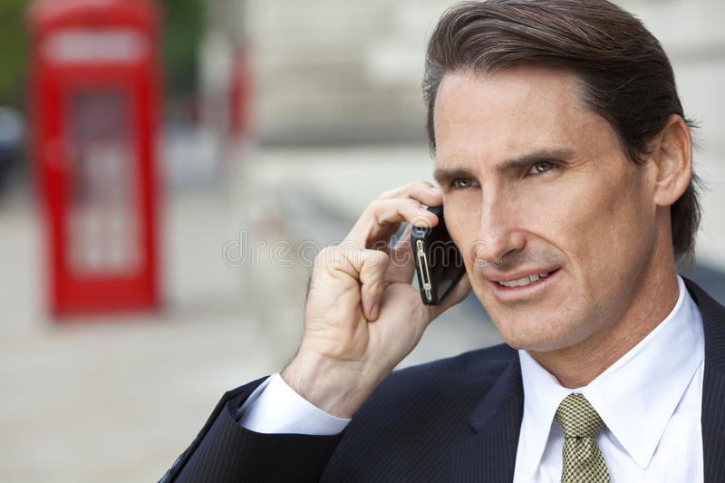Man On Cell Phone with London Red Telephone Box royalty free stock photo