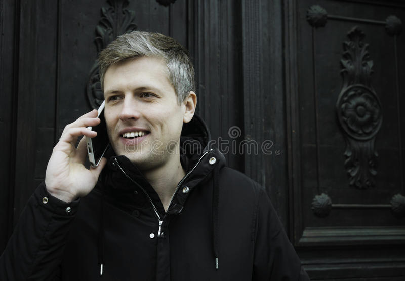 Man with cellphone stock images