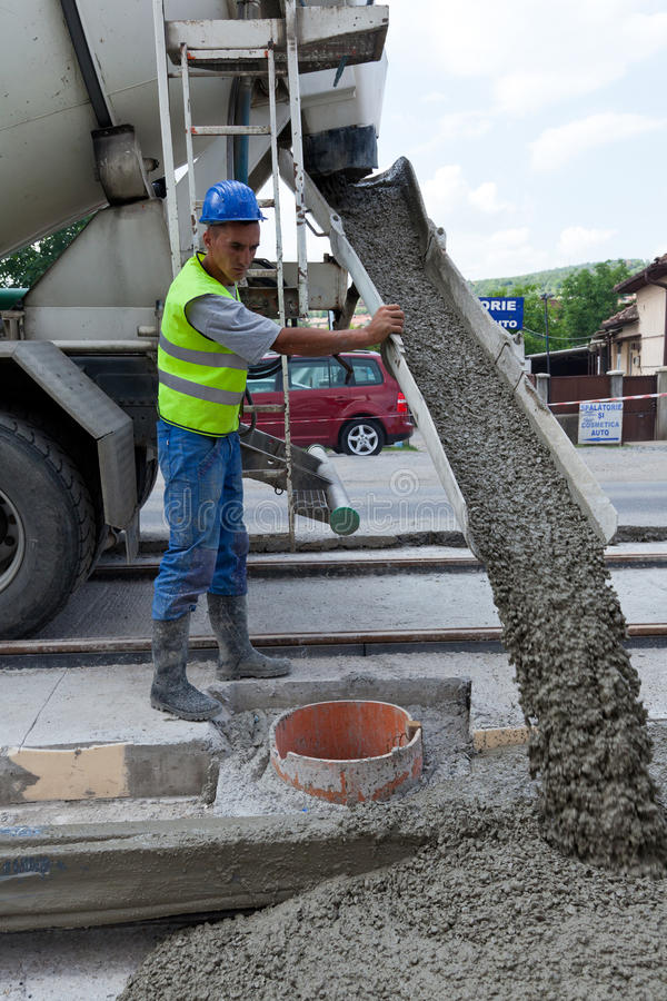 Man with cement machine stock image