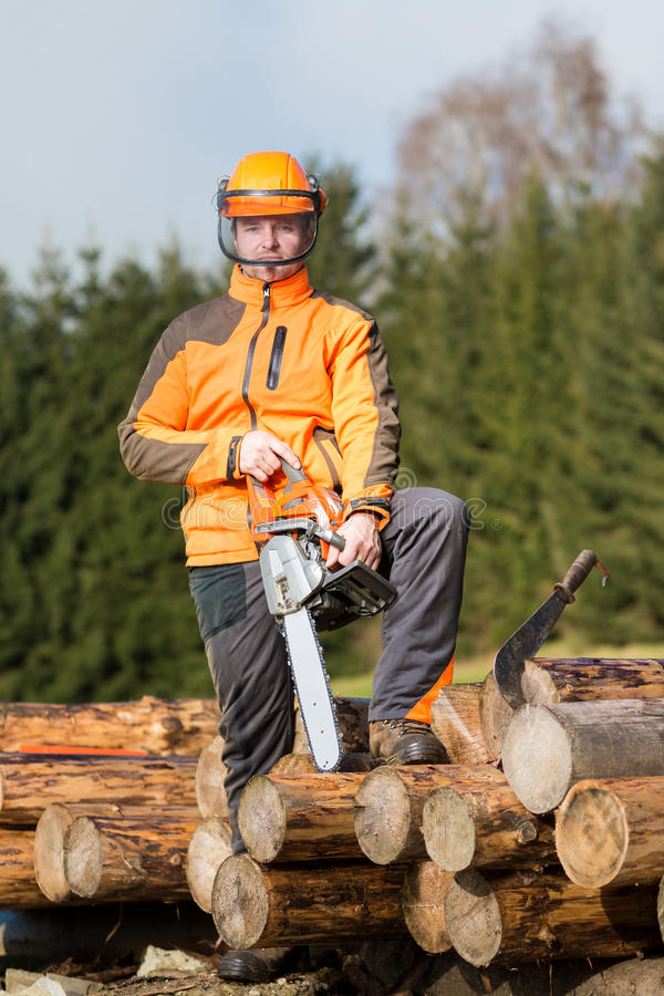 A man with a chainsaw. Outdoor royalty free stock images