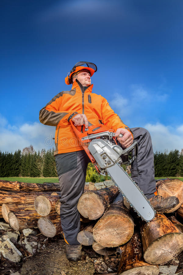 Man with chainsaw. A man with a chainsaw outdoor royalty free stock image